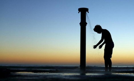 file-photo-of-a-boy-showering-off-after-sunset-at-the-beach-in-cardiff-by-the-sea-california